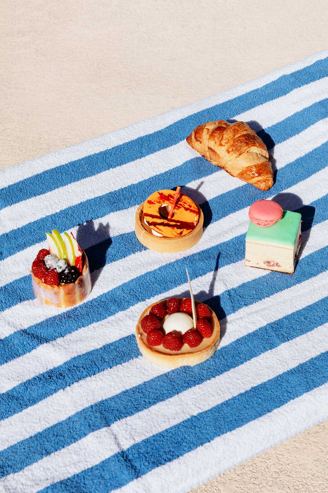 Pastries on a stripped towel. Kimberly Genevieve lifestyle photographer Los Angeles
