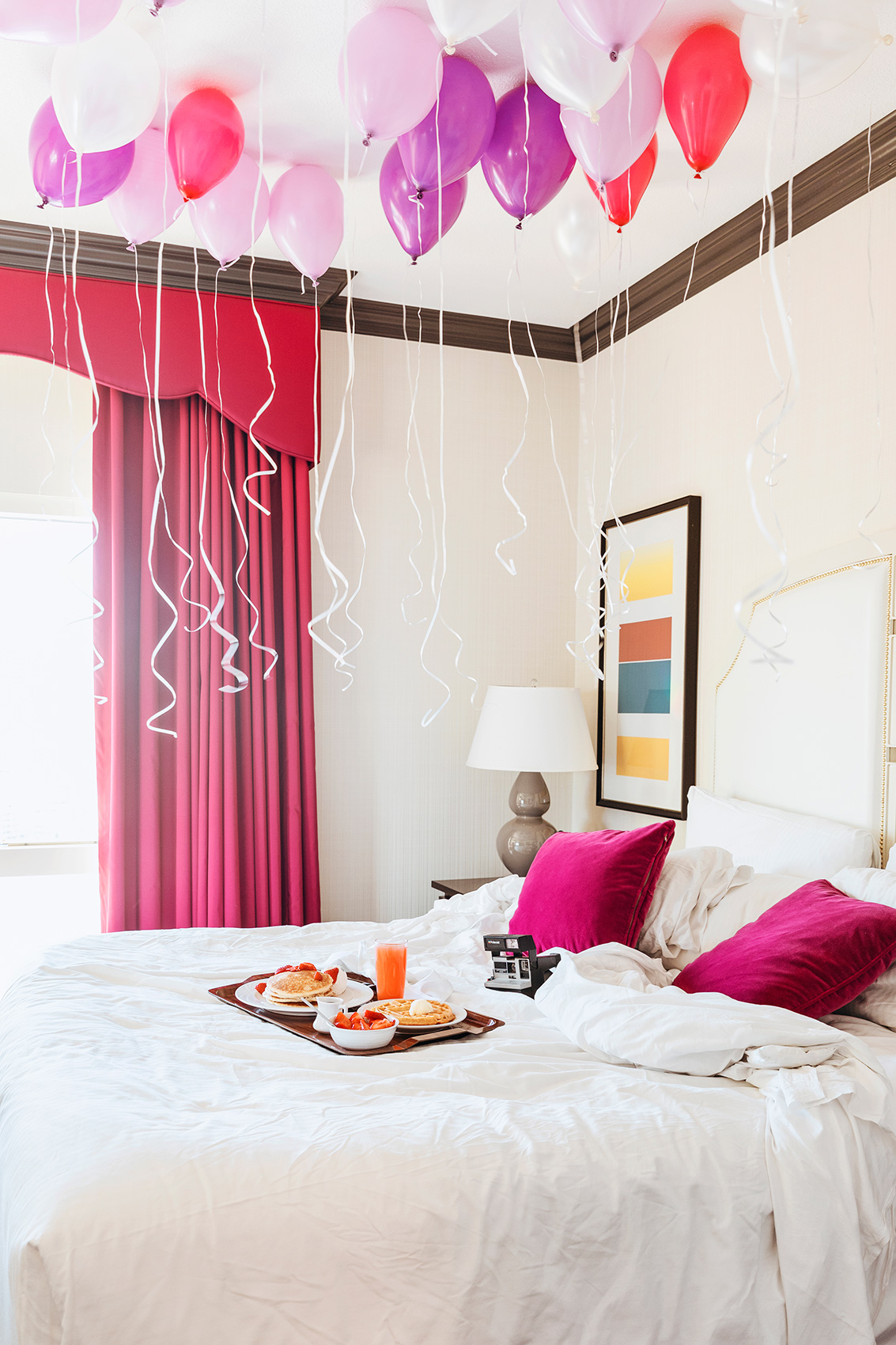 Breakfast in bed with balloons. Kimberly Genevieve lifestyle photographer Los Angeles