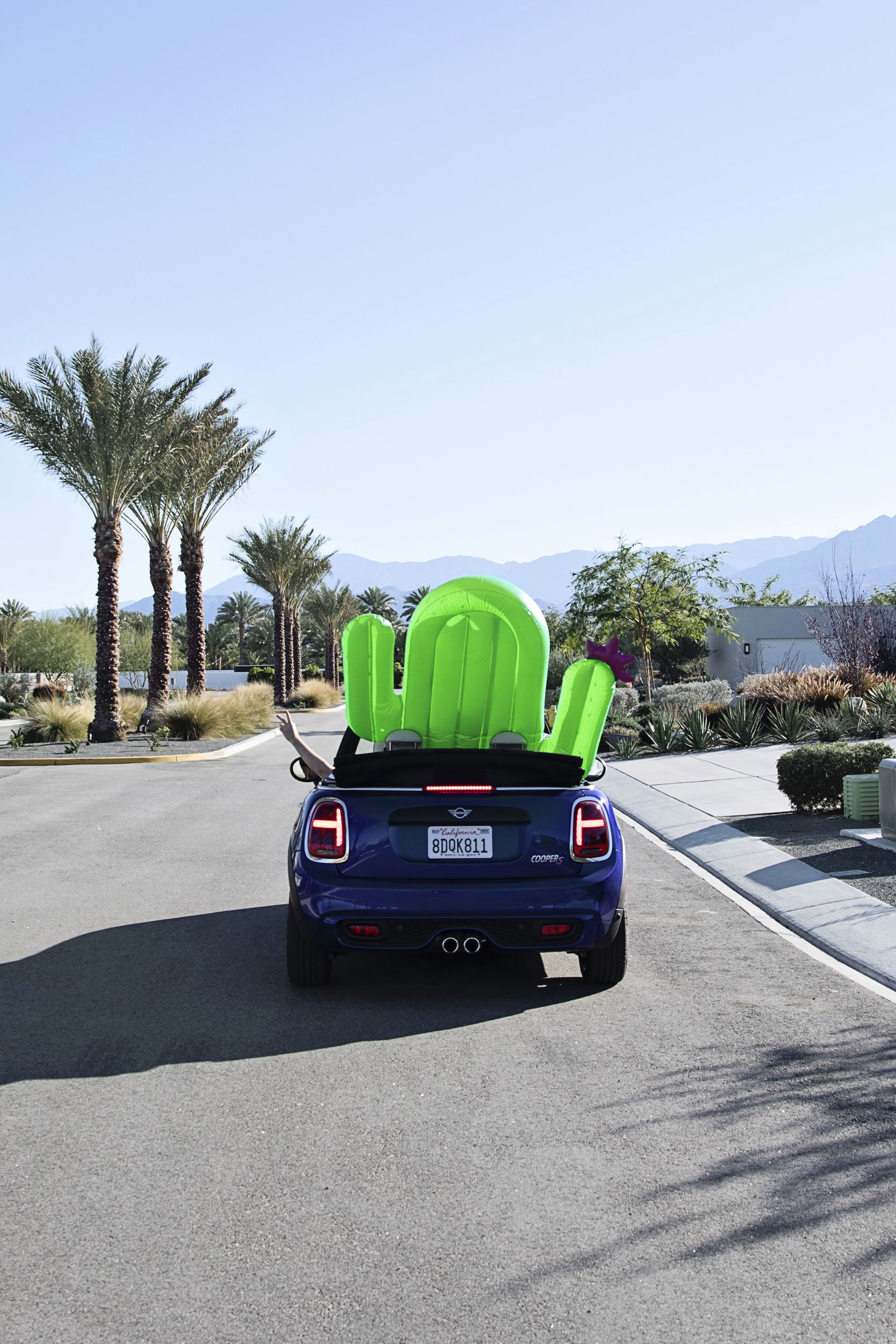 Mini USA convertible with pool floats. Kimberly Genevieve lifestyle photographer Los Angeles