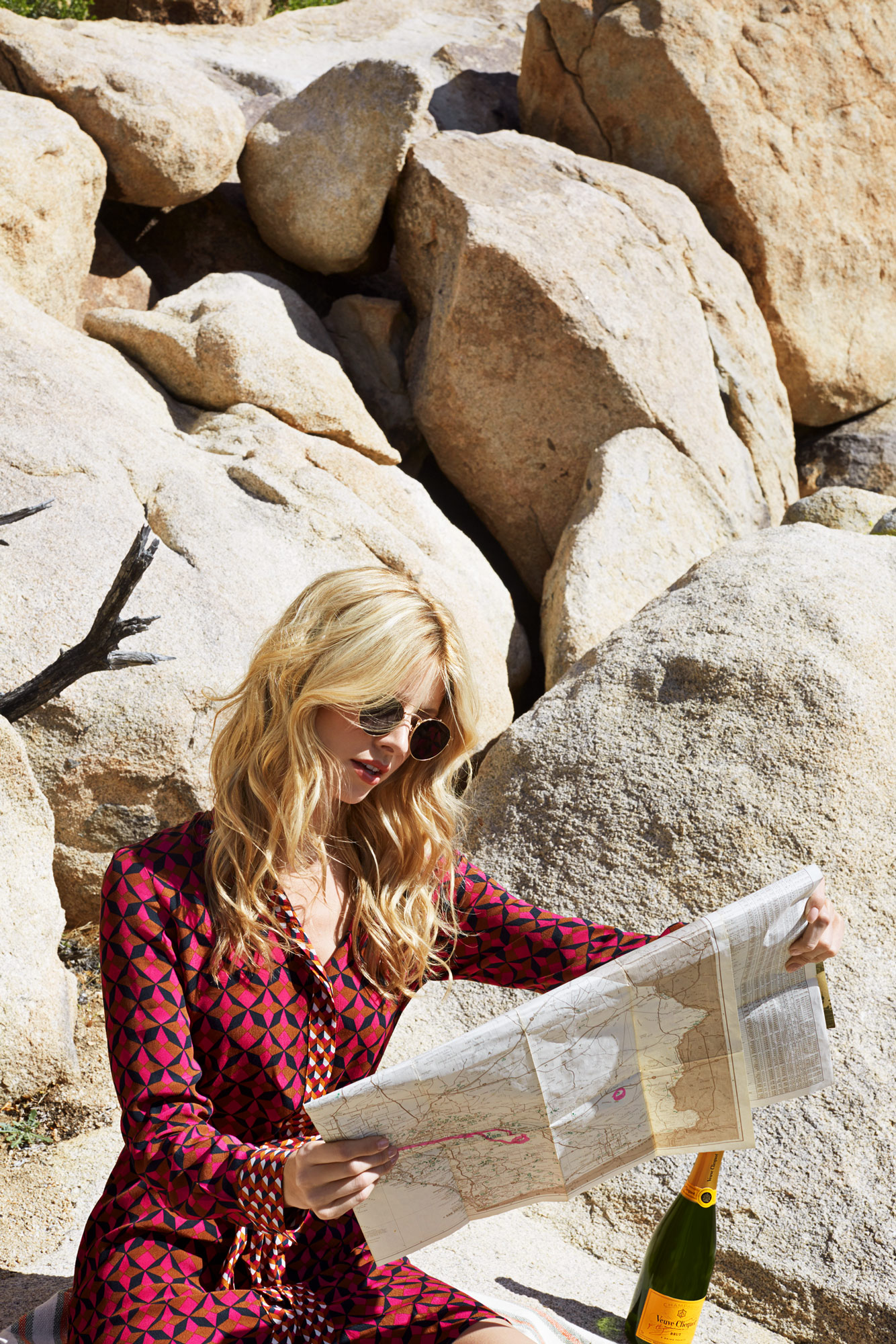 Girl sitting on a rock looking at a map. Kim Genevieve Los Angeles Lifestyle Photographer