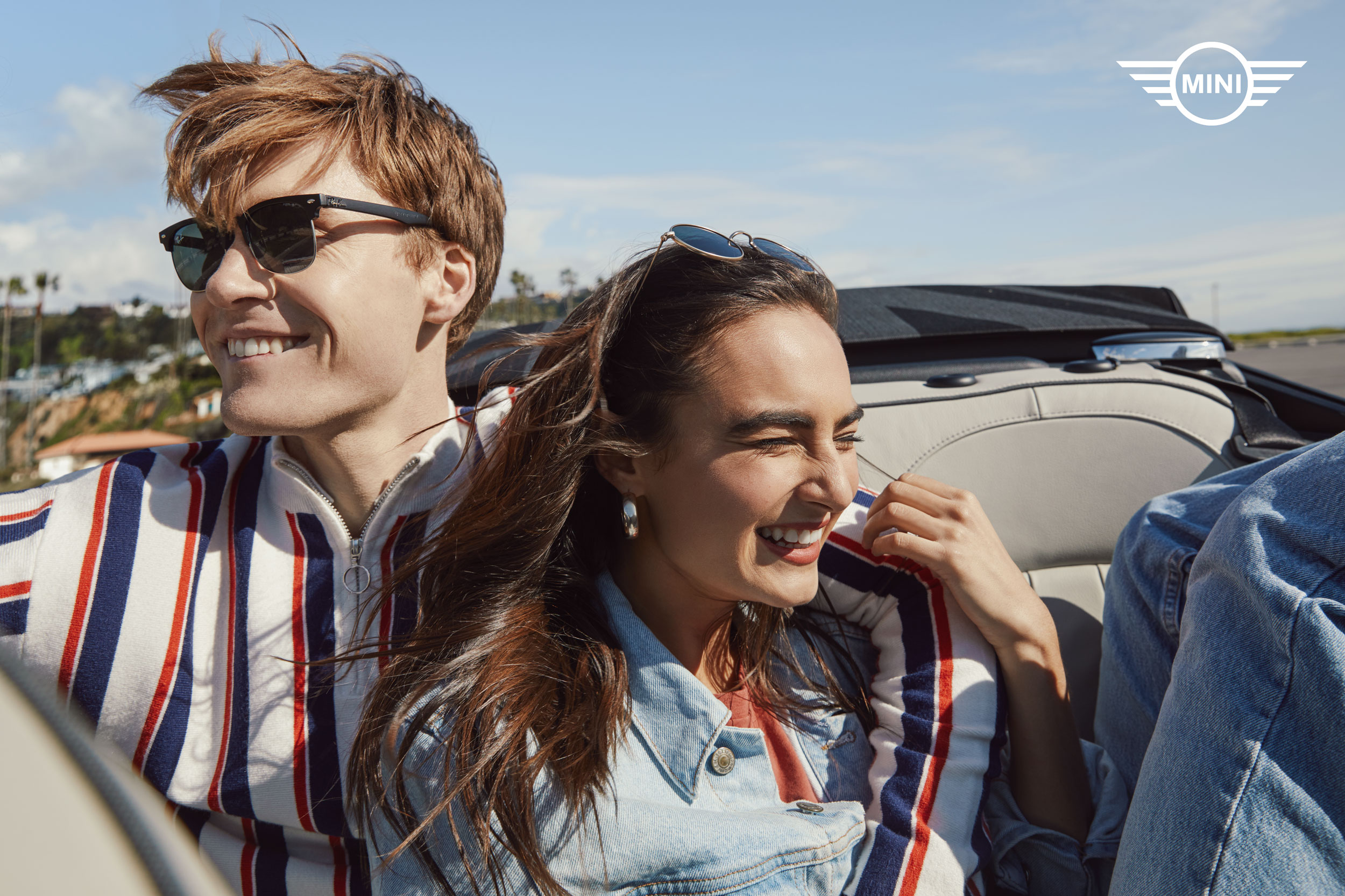 Millennial couple in the backseat of a convertible mini cooper - Kimberly Genevieve Los Angeles Advertising Photographer