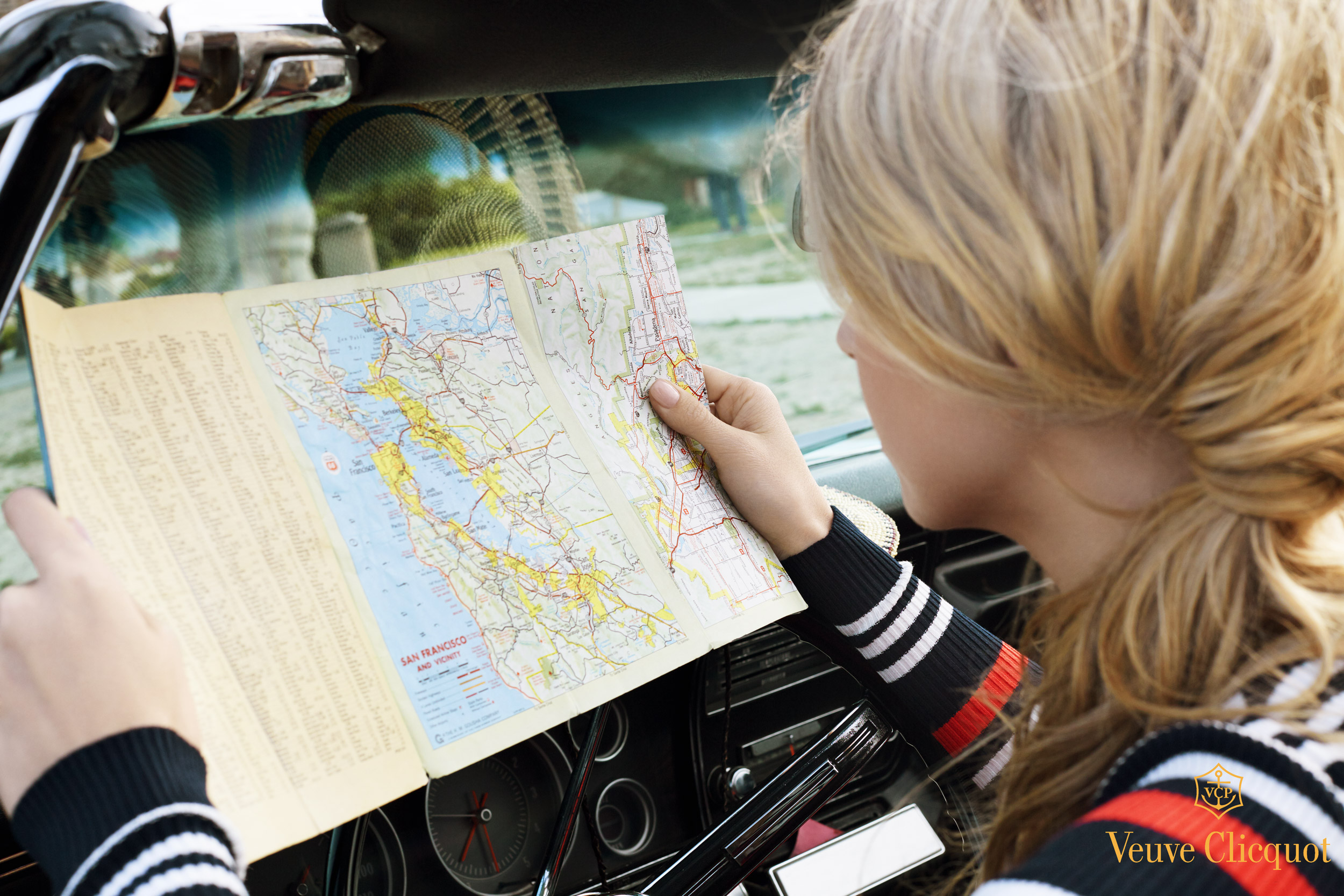 Girl looking at a map in a car - Kim Genevieve Los Angeles Lifestyle Photographer