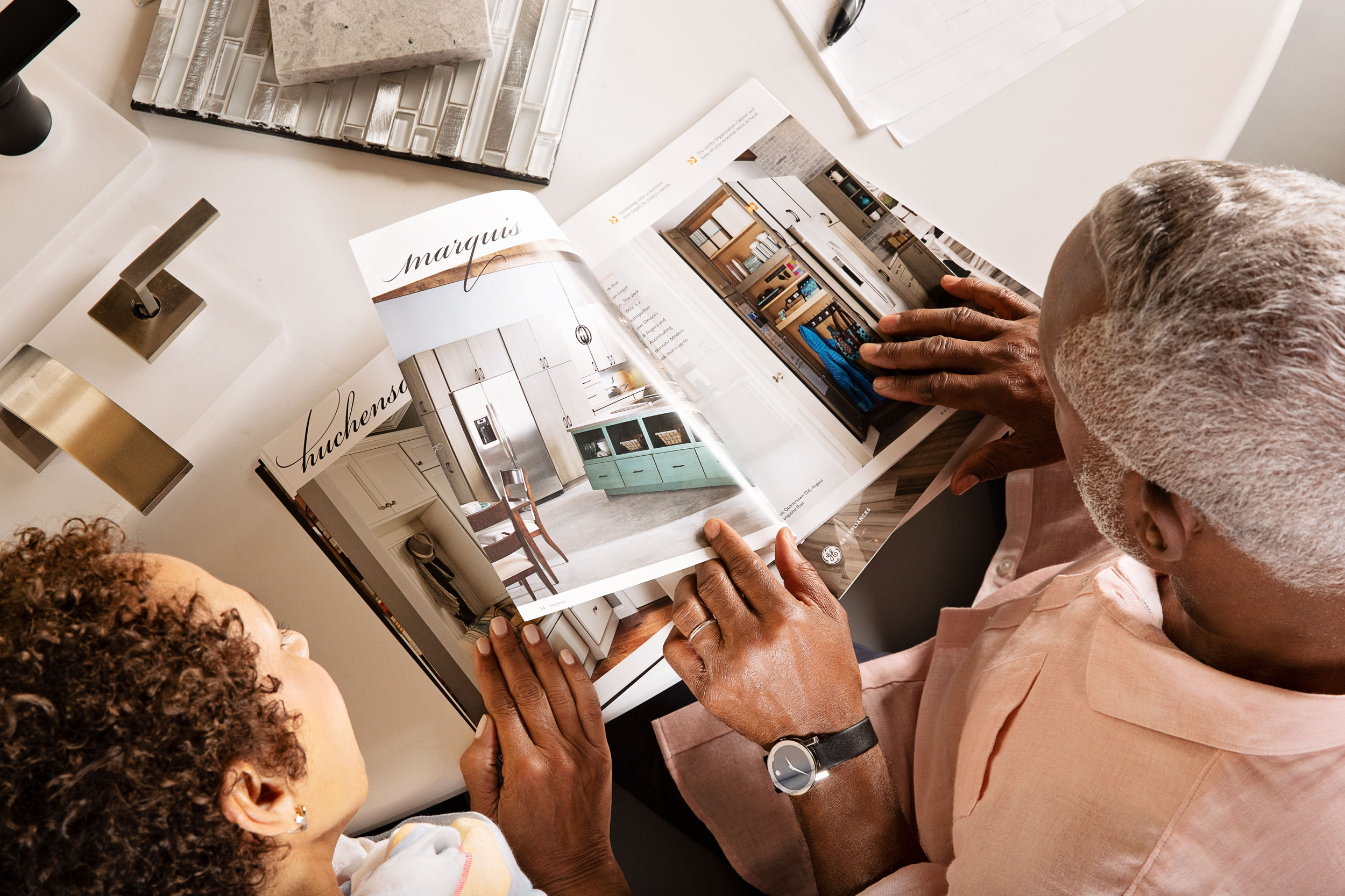 Older couple look over design samples in a showroom