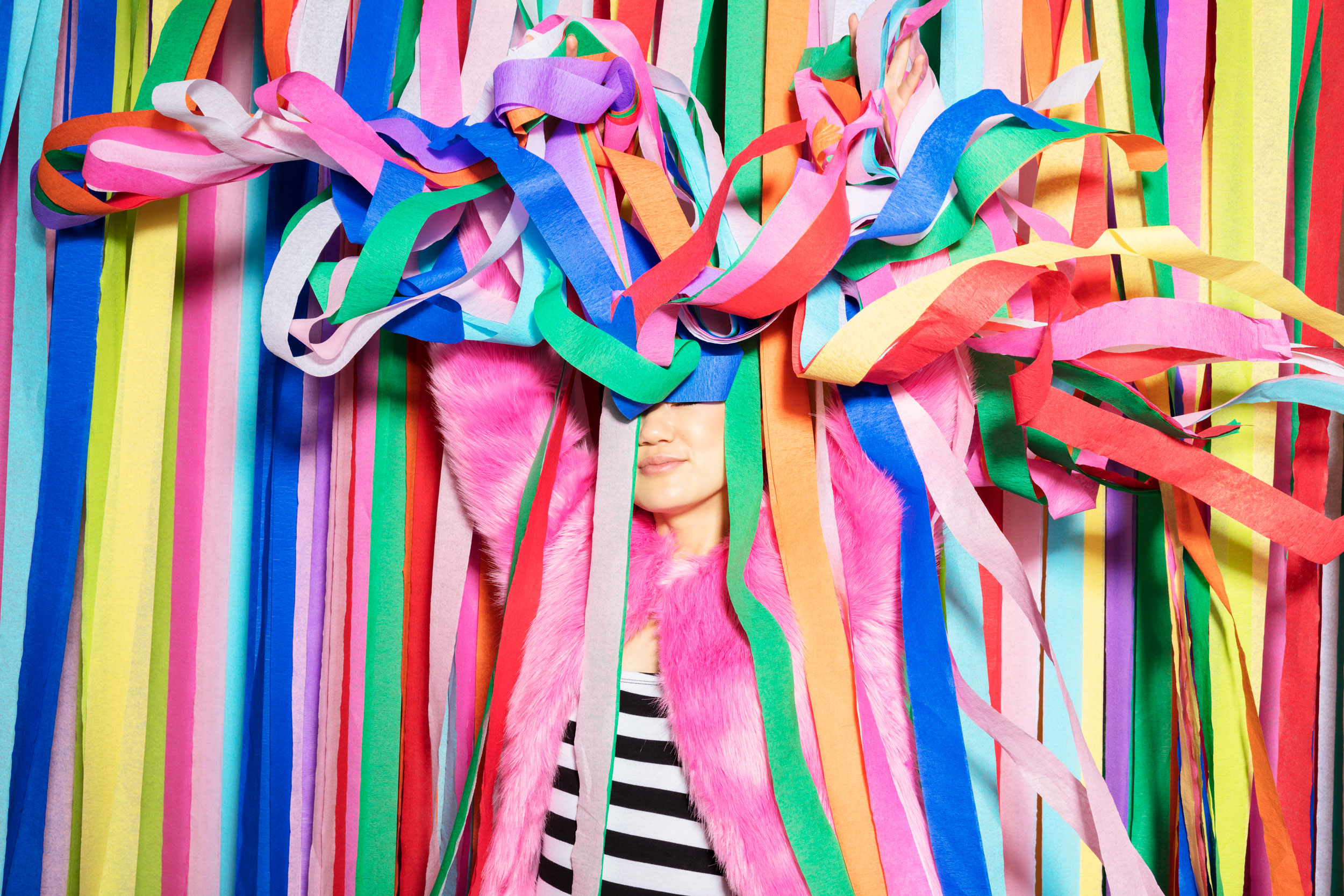Girl laughing and smiling playing with streamers