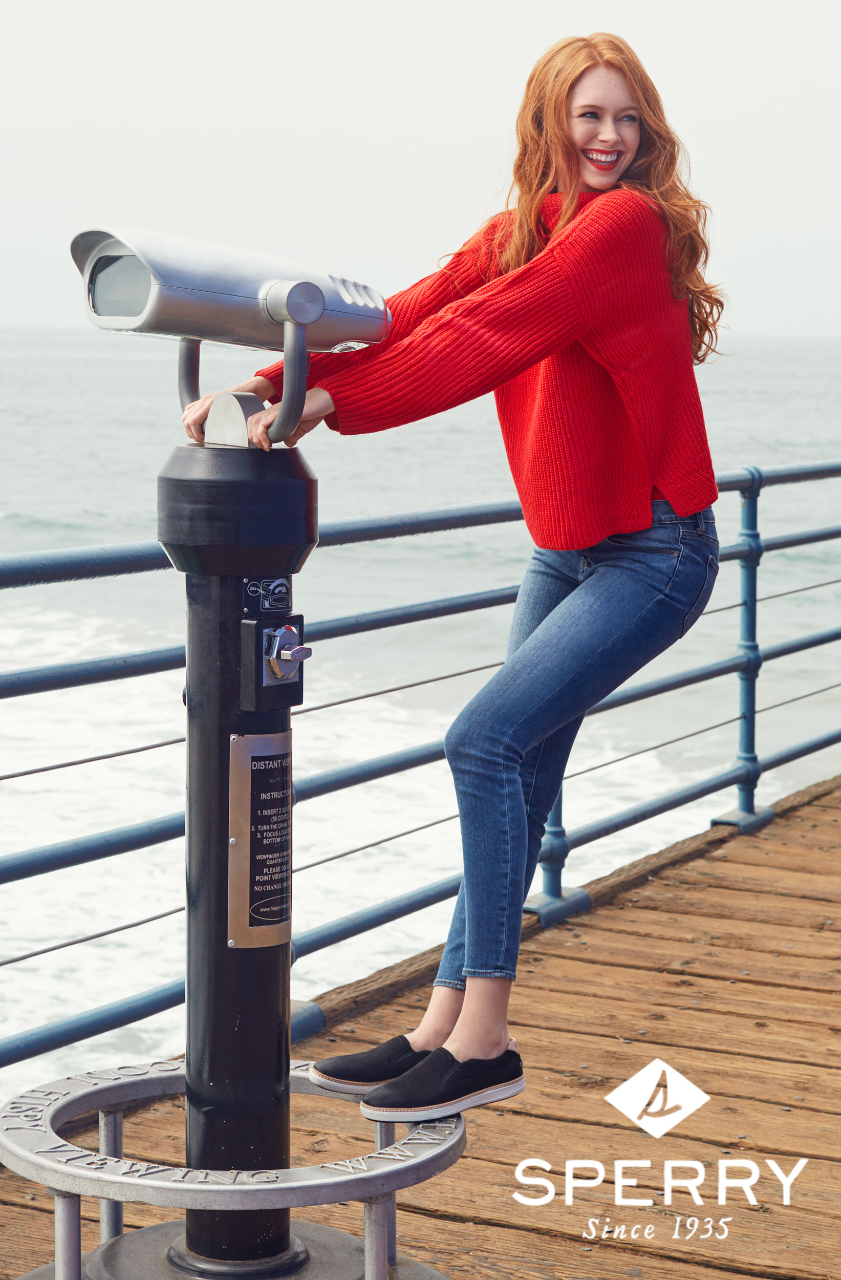 Girl in a red sweater playing on a pier. Kim Genevieve Los Angeles Lifestyle Photographer