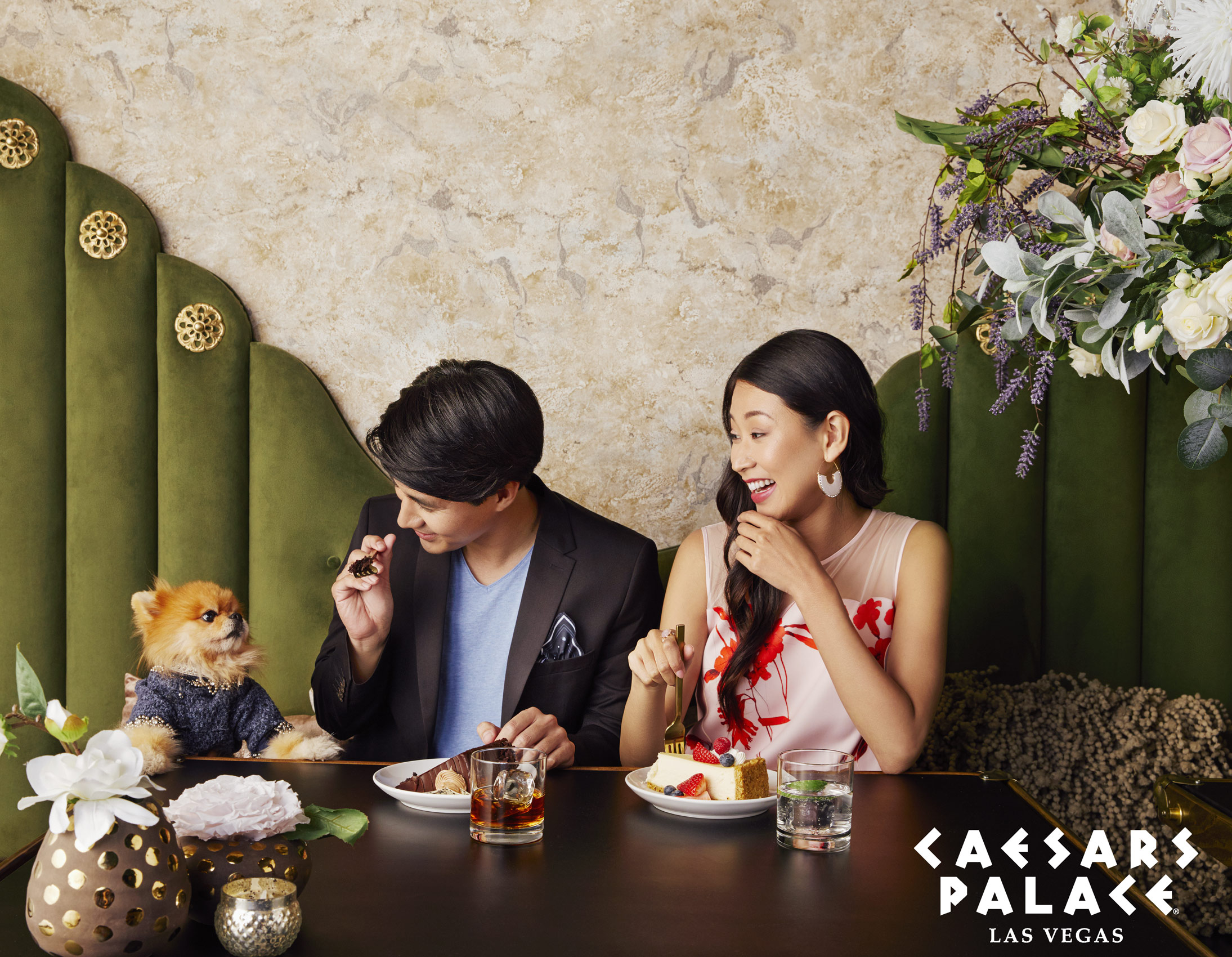 Couple sitting at a restaurant feeding their dog at the table - Kimberly Genevieve Los Angeles Advertising Photographer