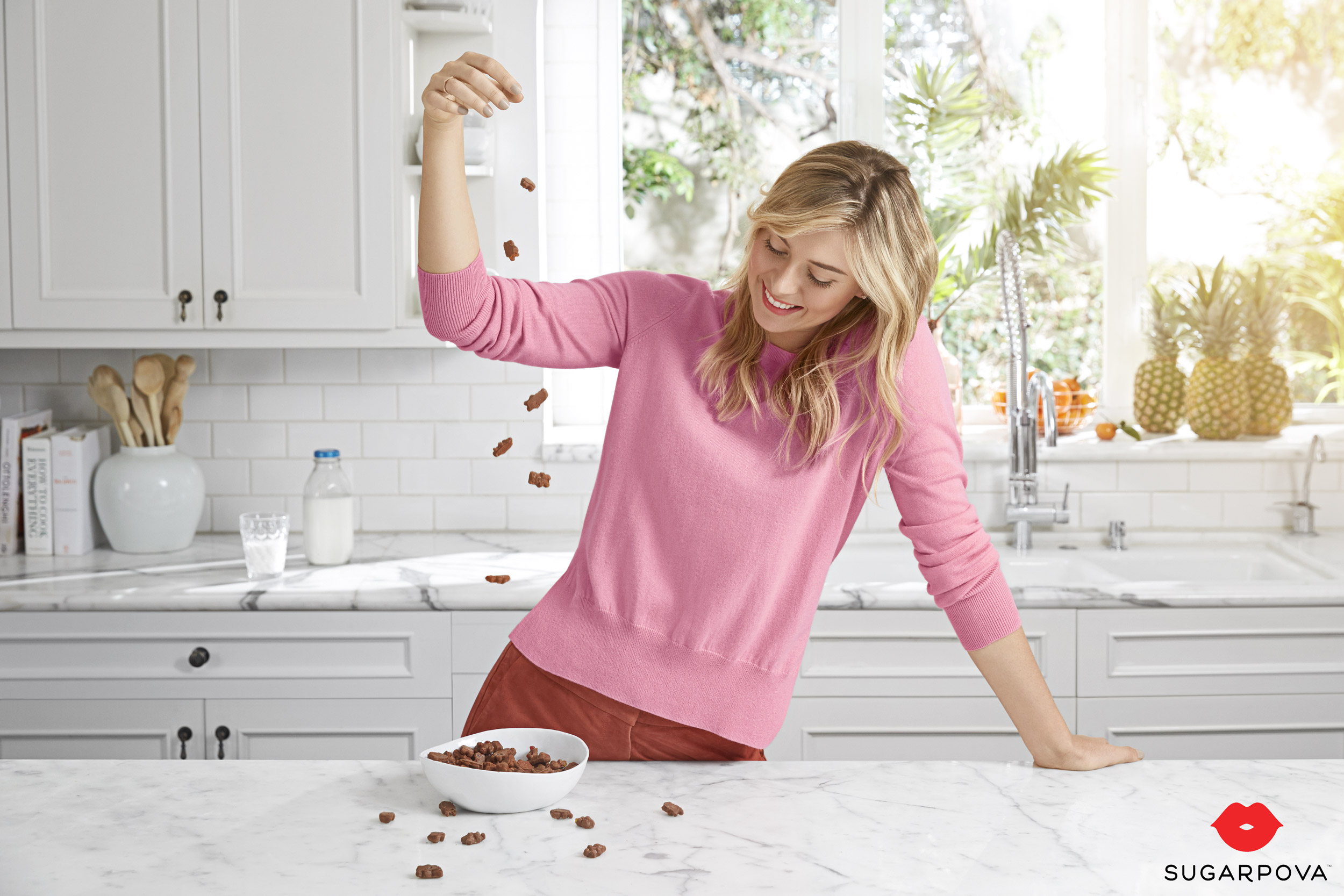 Maria Sharapova in the kitchen dropping chocolate gummy bears - Kimberly Genevieve Los Angeles Celebrity Photographer