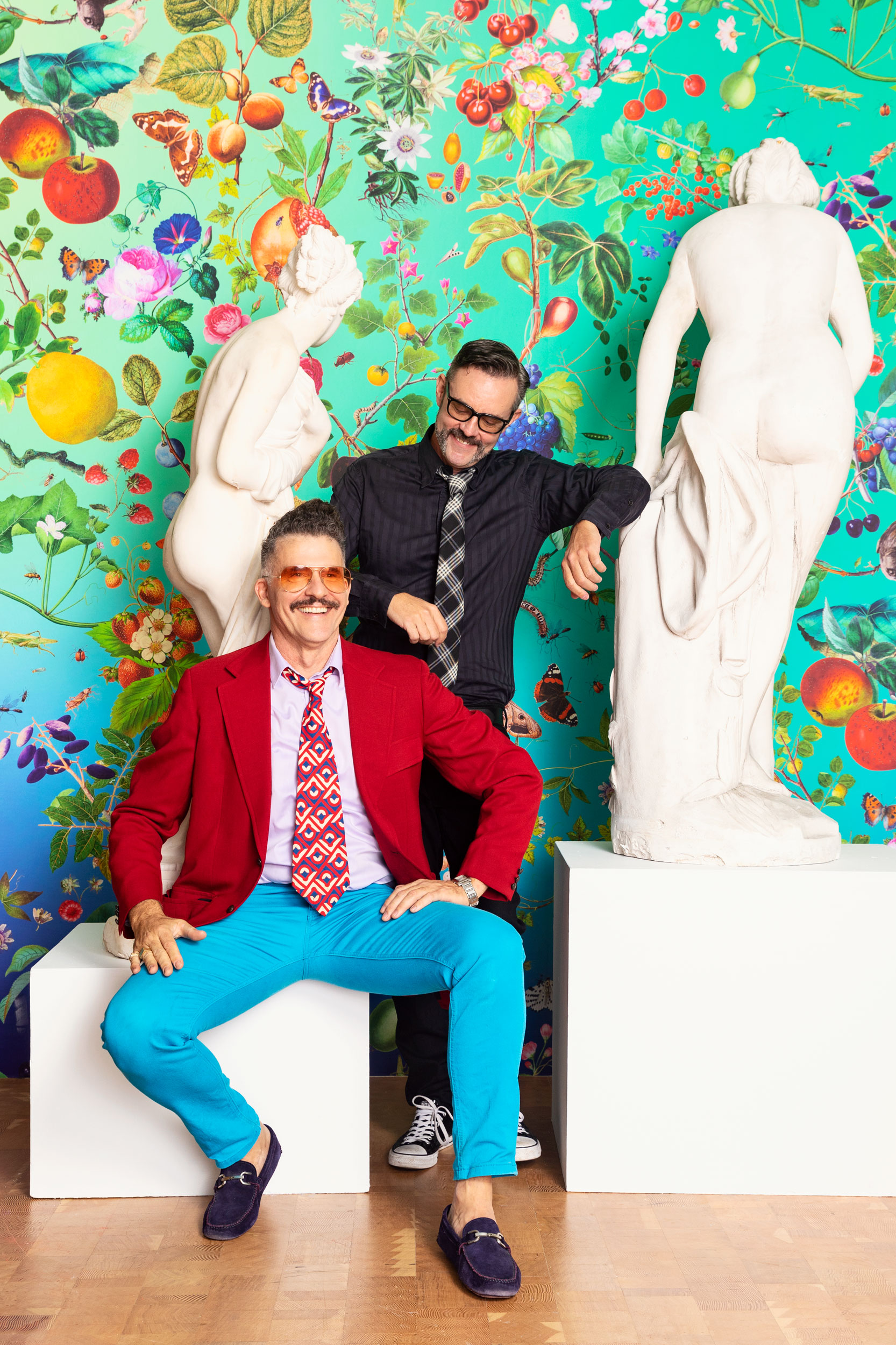 Two men standing with statues in an art installation. Kim Genevieve Los Angeles Portrait Photographer