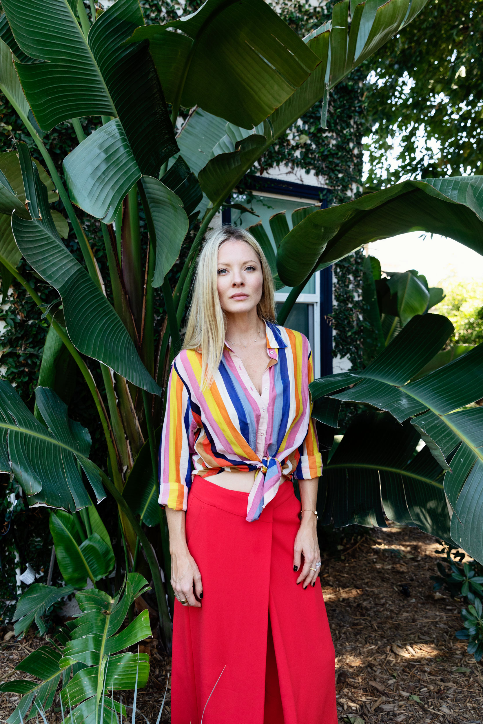 Kaitlin Doubleday wearing red pants and a striped shirt. Kim Genevieve Los Angeles Portrait Photographer