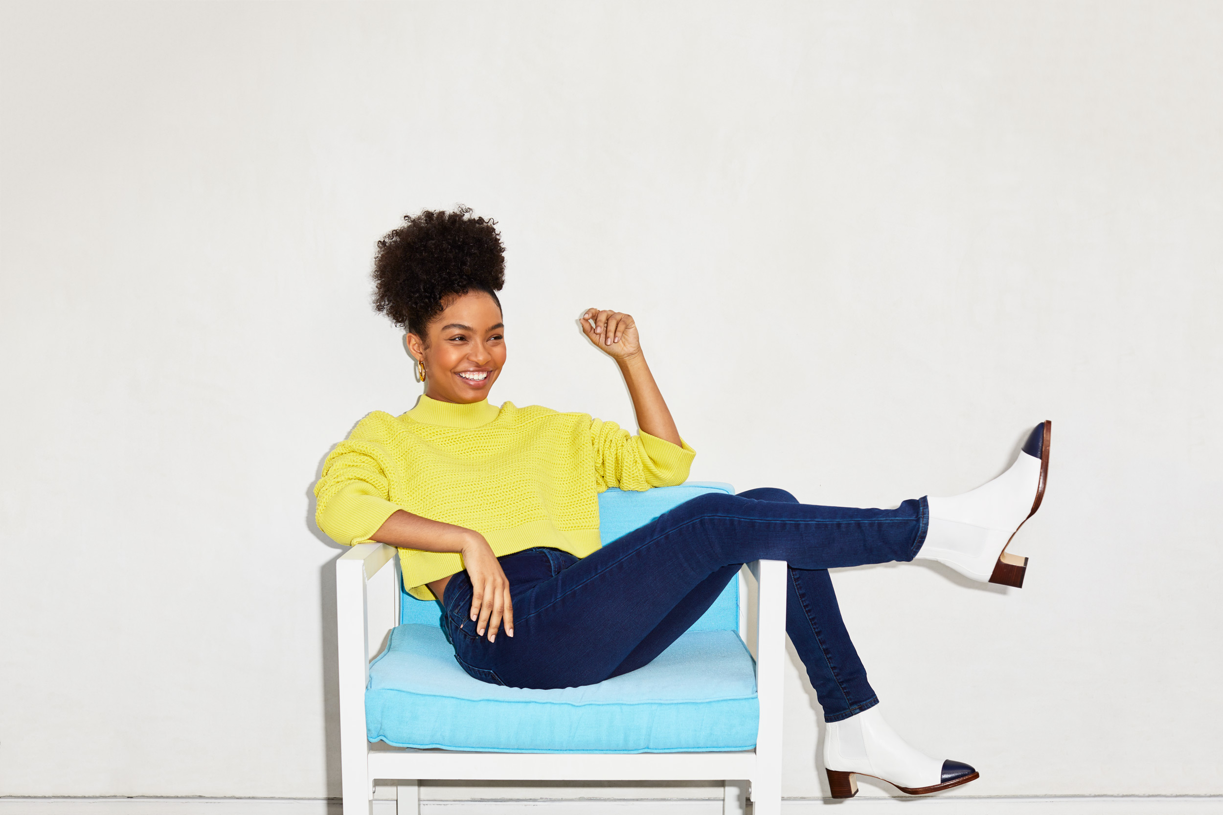 Actress Yara Shahidi wearing a yellow sweater and denim jeans. Kim Genevieve Los Angeles Portrait Photographer