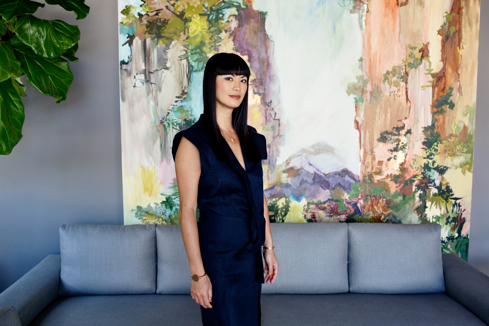 Woman wearing a blue dress in a living room. Kim Genevieve Los Angeles Portrait Photographer