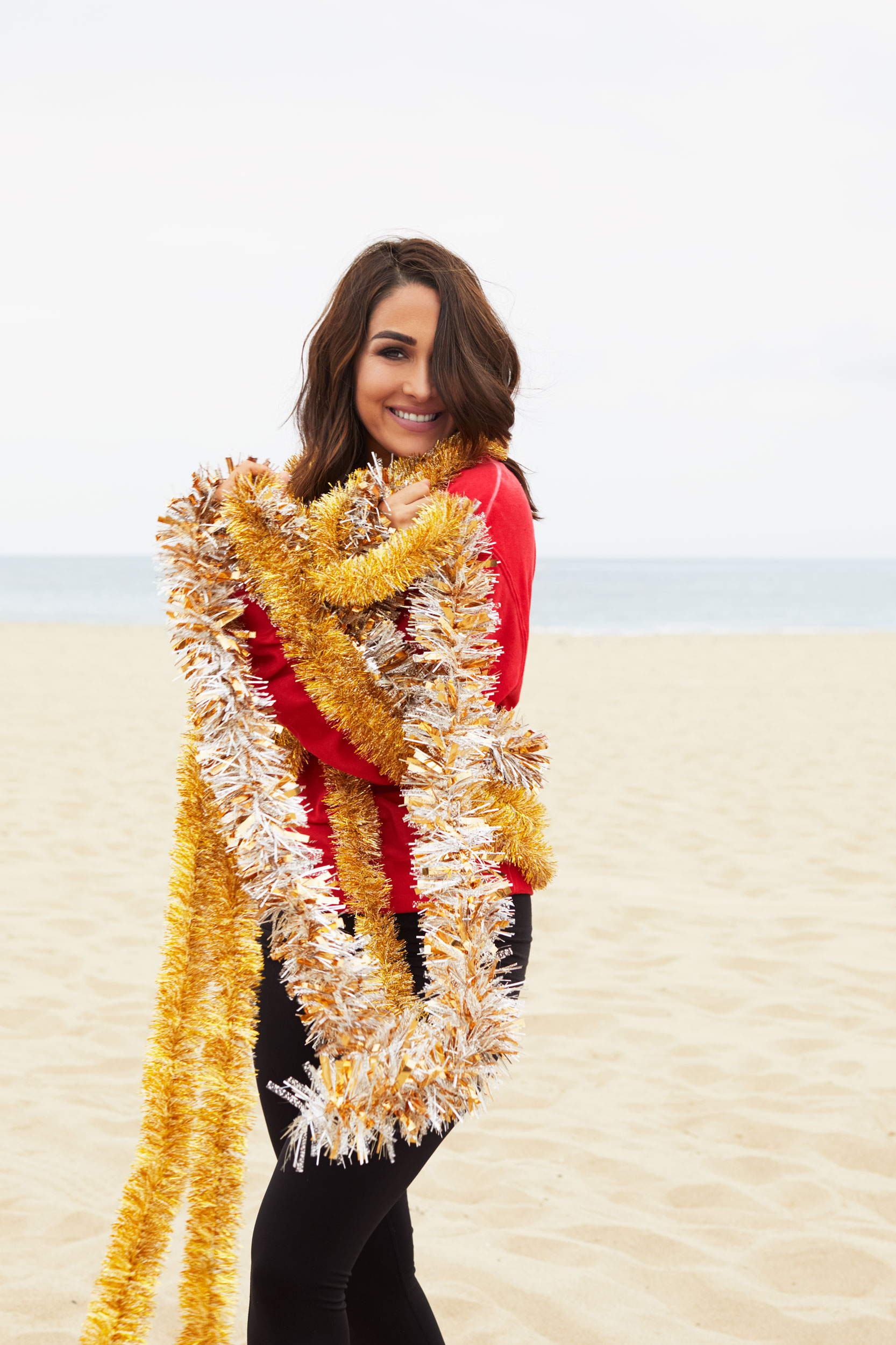 WWE diva Bree Bella on the beach with Christmas garland. Kim Genevieve Los Angeles Portrait Photographer