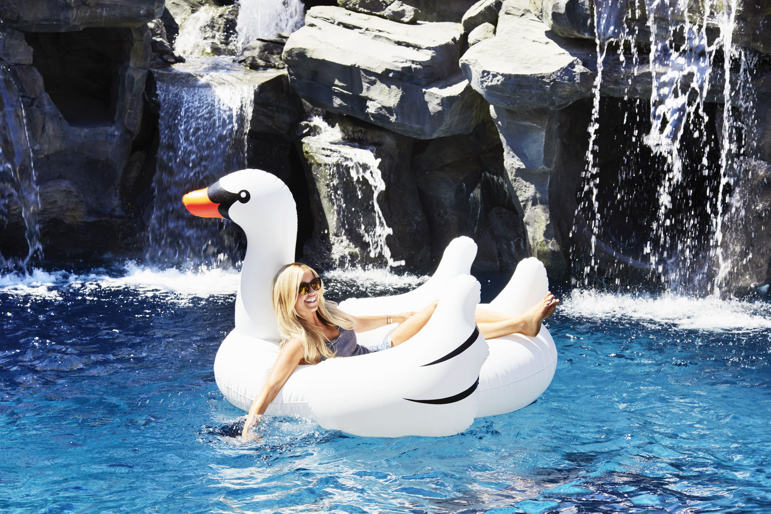 HGTV Christina El Moussa on a swan pool float. Kim Genevieve Los Angeles Portrait Photographer