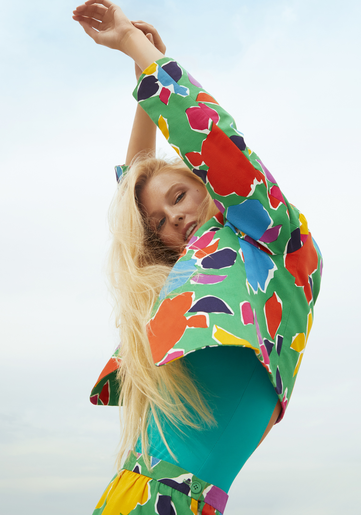 Girl with blond wearing a green suit at the beach. Kim Genevieve Los Angeles Portrait Photographer