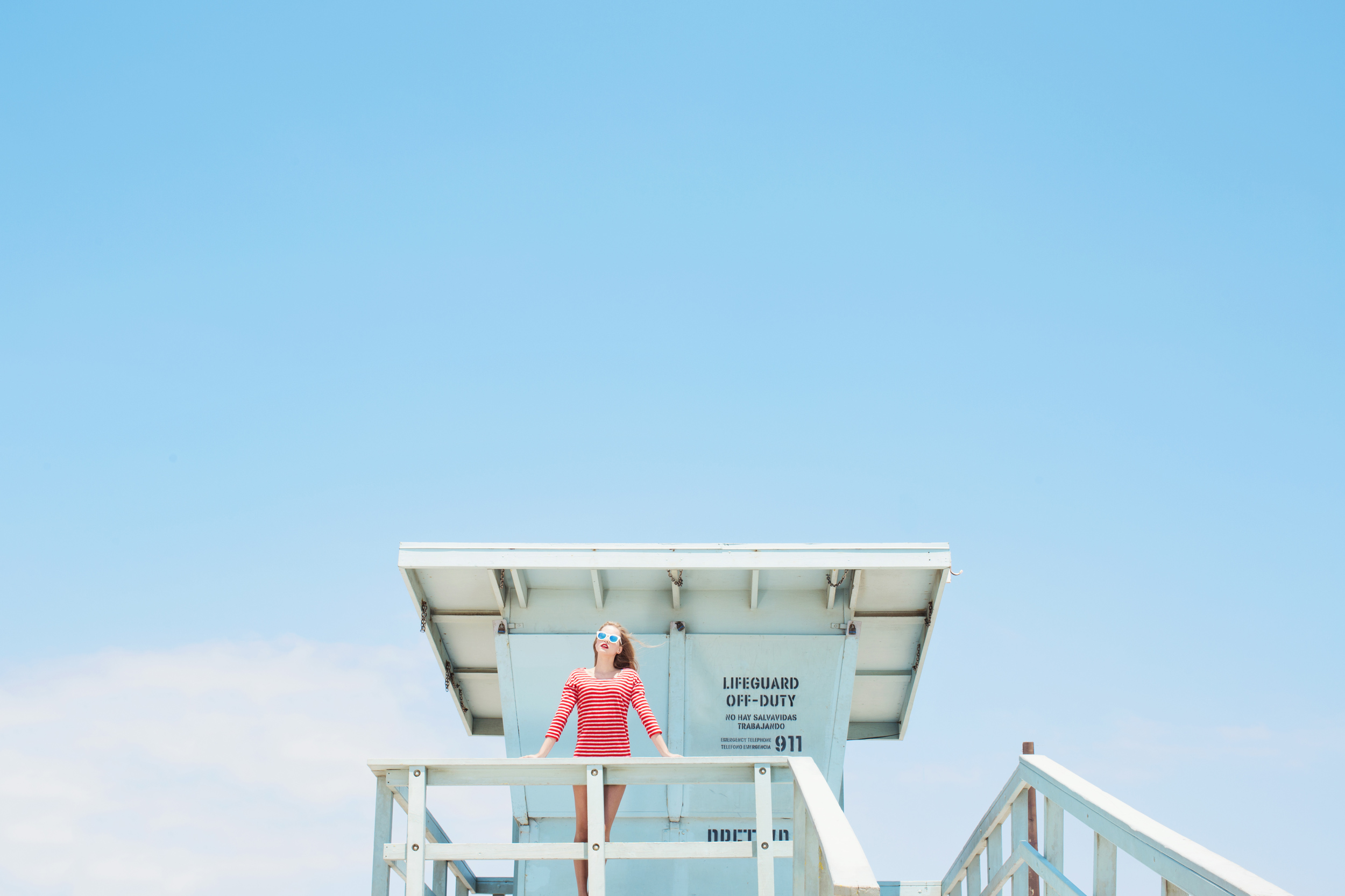 Girl standing on a lifeguard tower with sunglasses - Kim Genevieve Los Angeles Lifestyle Photographer