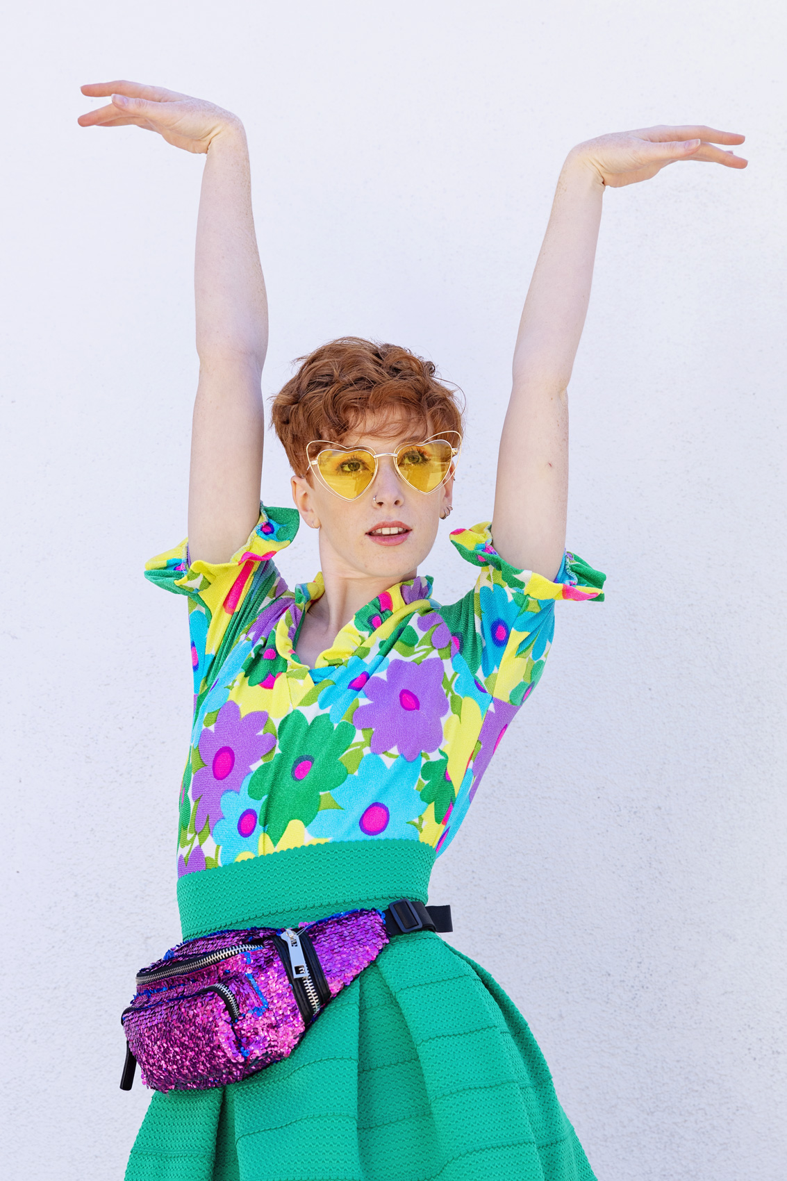 LGBTQ youth wearing a floral shirt and yellow sunglasses - Kim Genevieve Los Angeles Lifestyle Photographer