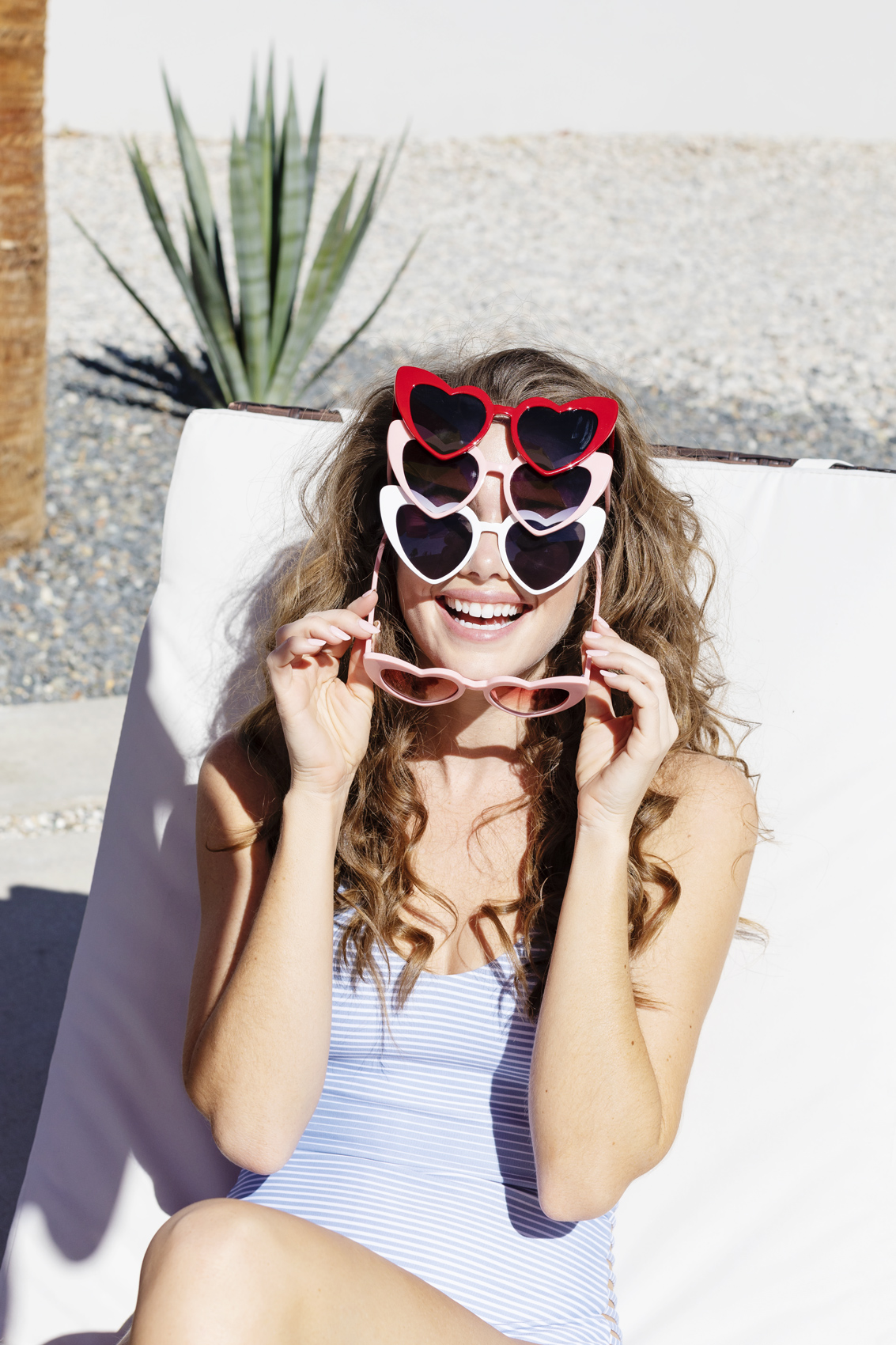 Girl wearing heart sunglasses outside in the sun