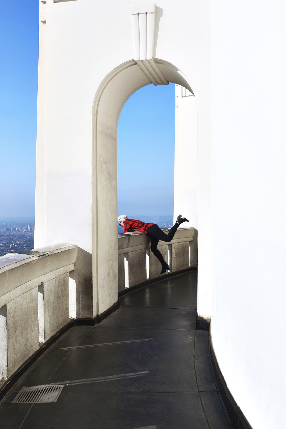 A girl at the Griffith Observatory leaning over a railing. Kim Genevieve Los Angeles Lifestyle Photographer