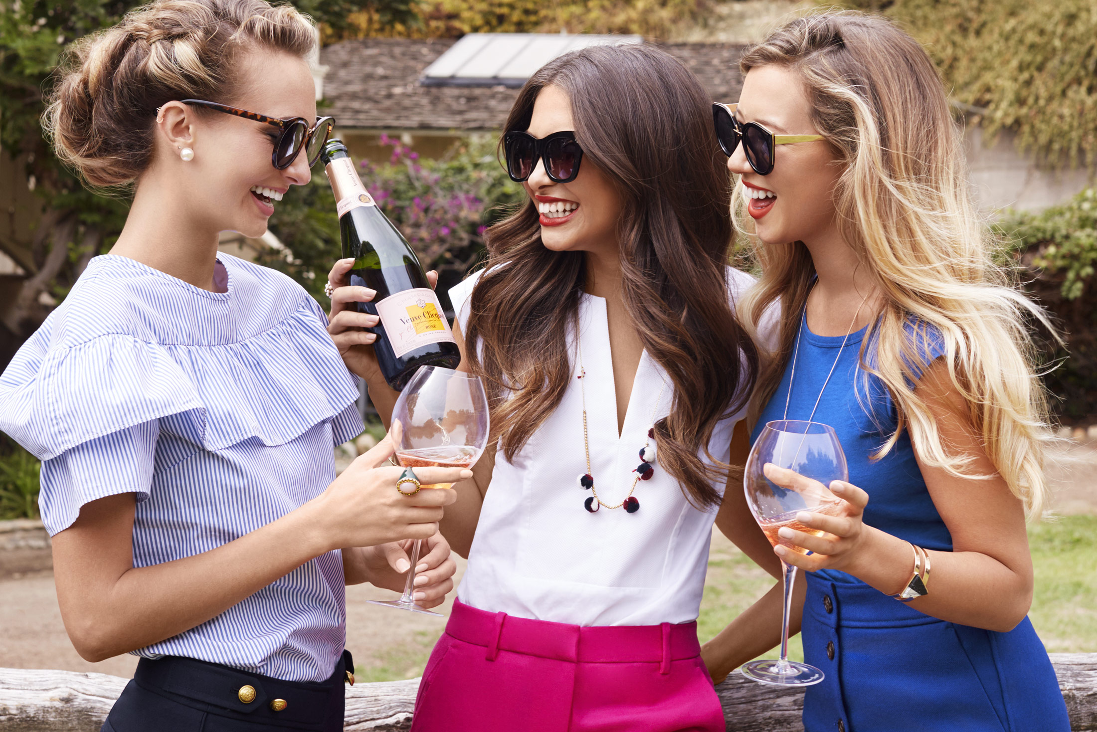Girls laughing over champagne - Kim Genevieve Los Angeles Lifestyle Photographer