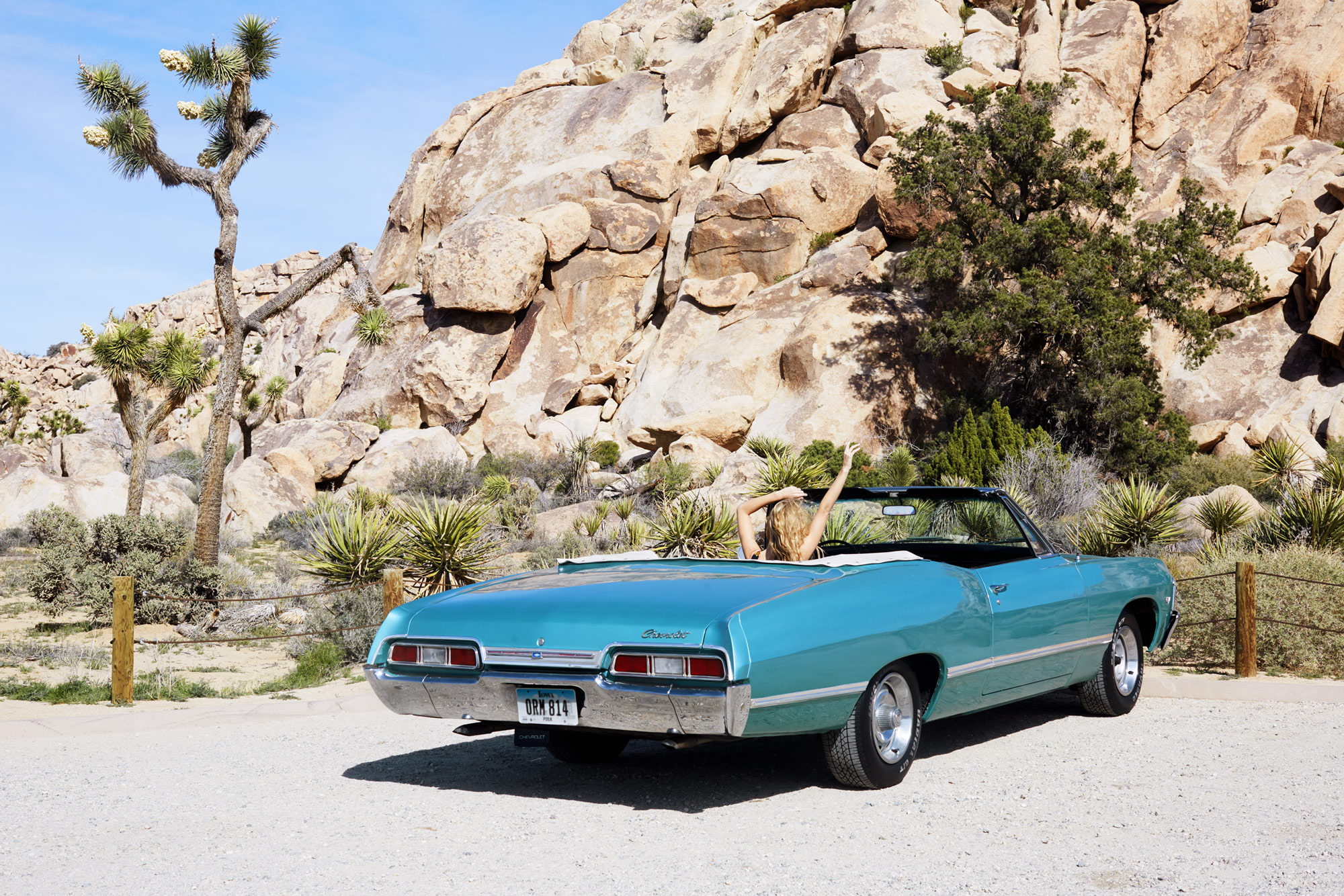 A convertible parked in the desert. Kim Genevieve Los Angeles Lifestyle Photographer
