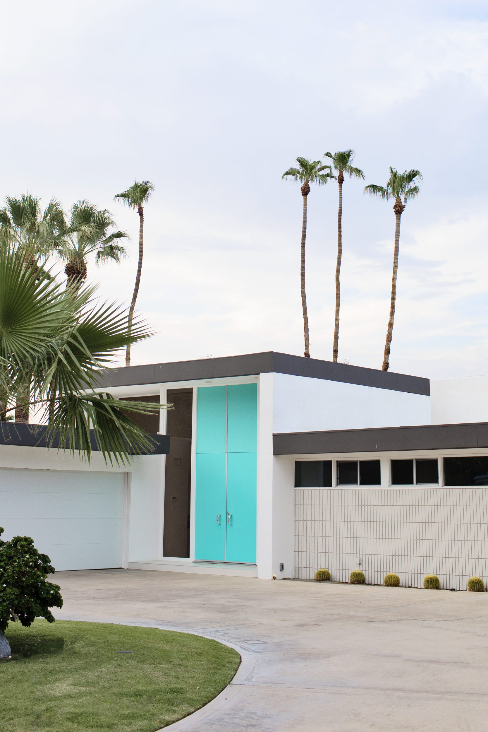 A home in Palm Springs with a blue door. Kimberly Genevieve lifestyle photographer Los Angeles