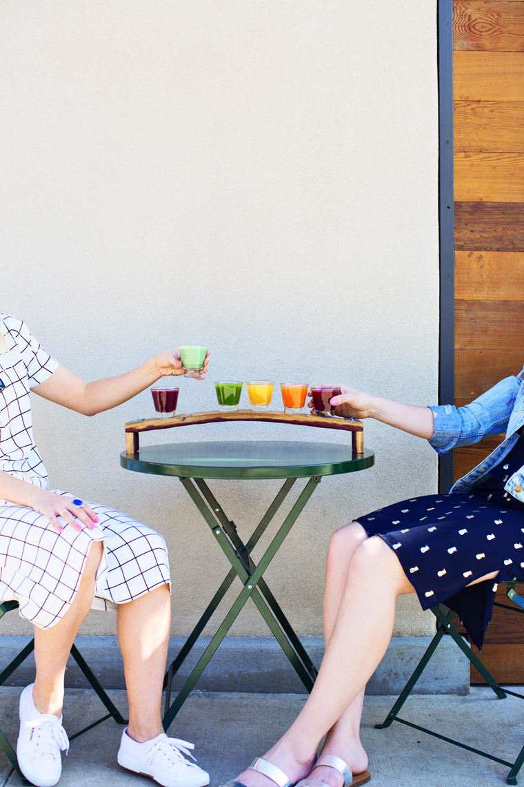 Two girls enjoying fresh pressed juices. Kimberly Genevieve lifestyle photographer Los Angeles