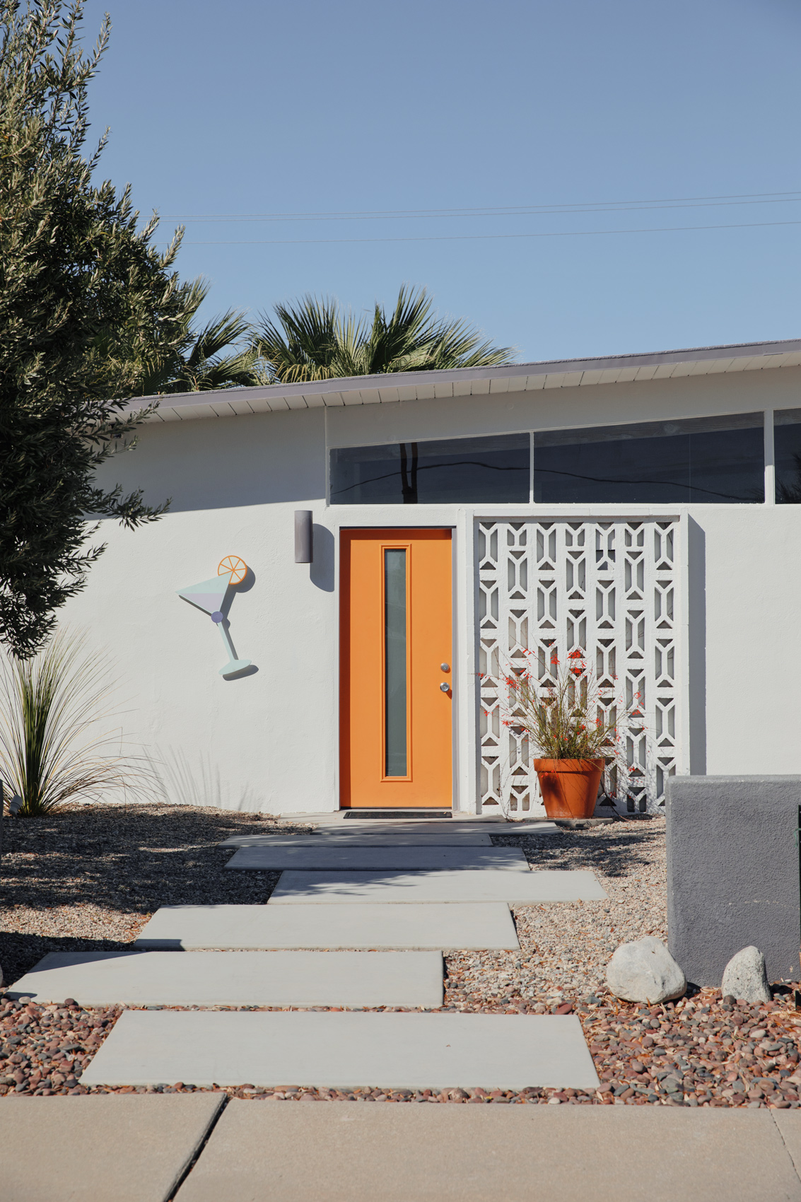 Orange door on a home in Palm Springs. Kimberly Genevieve lifestyle photographer Los Angeles